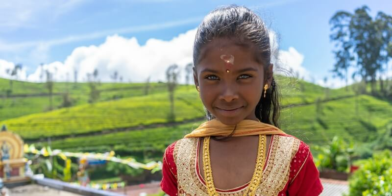 Sri Lankan girl standing in front of a field