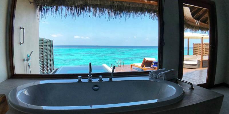 Bath with an ocean view