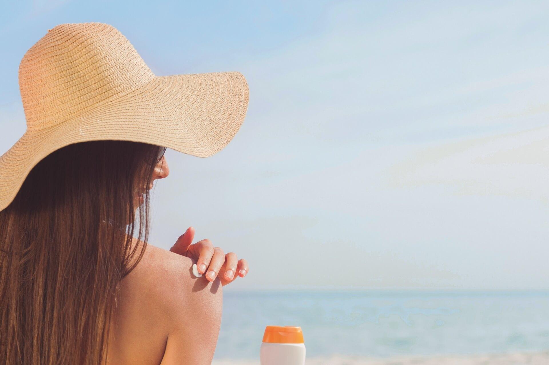 A woman applying sunblock