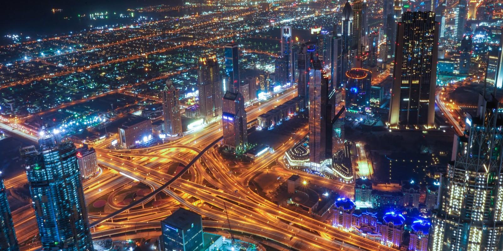 UAE, Dubai skyline by night
