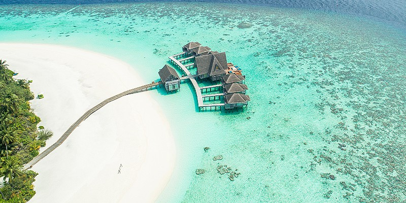 aerial view of some over water villas in the Maldives