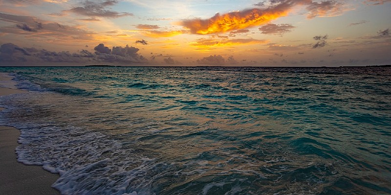 sunset from a beach in the Maldives