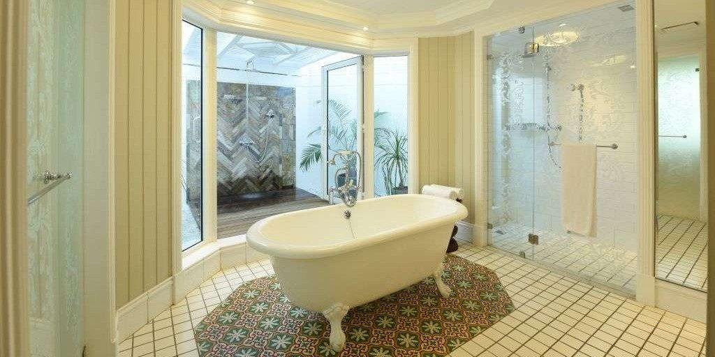 Standalone bath in a bathroom at Heritage Le Telfair Golf & Spa Resort
