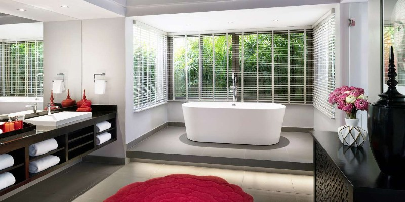 Luxurious soaking bathtub in the bathroom of an Ocean View Pool Villa at the Pavilions Phuket