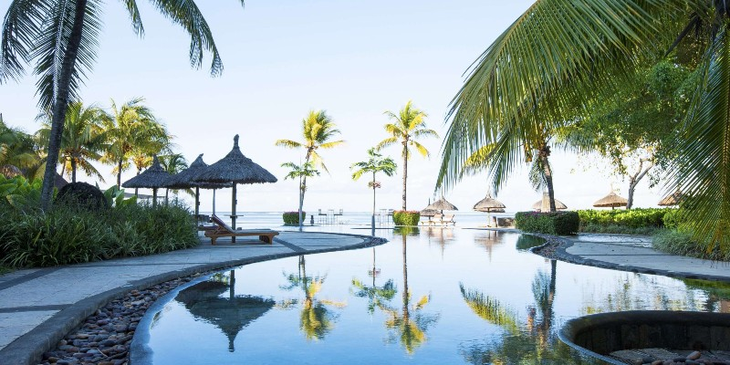 Palm trees dominate the views from the infinity pool at Heritage Awali Golf & Spa Resort