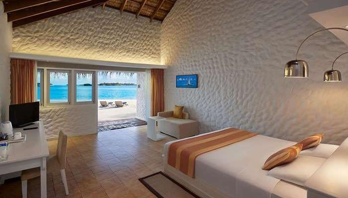 Interior shot of a room at Cinnamon Dhonveli Maldives