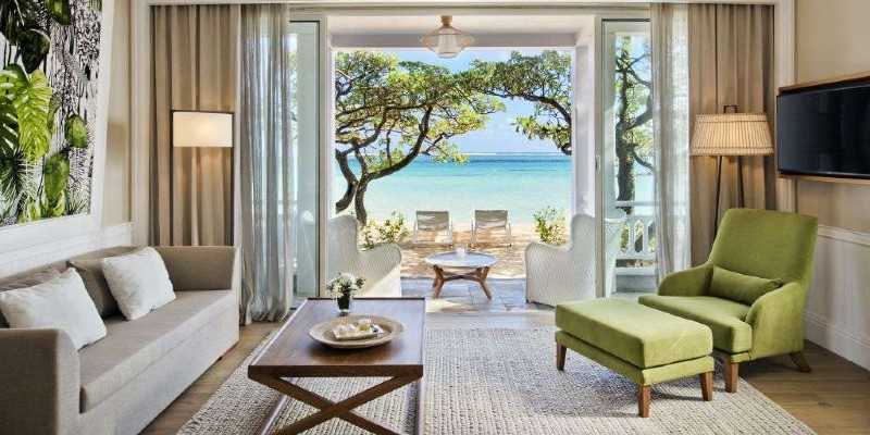 Living room space with a view of the ocean at Heritage Le Telfair Golf & Spa Resort