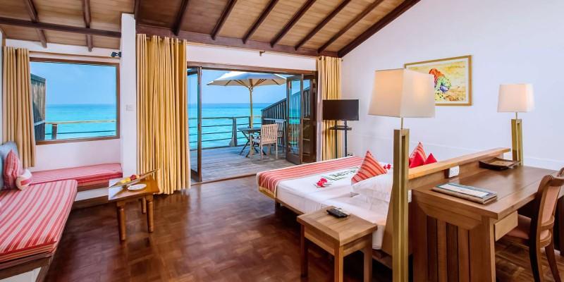 Interior shot of a water villa at Reethi Beach Resort