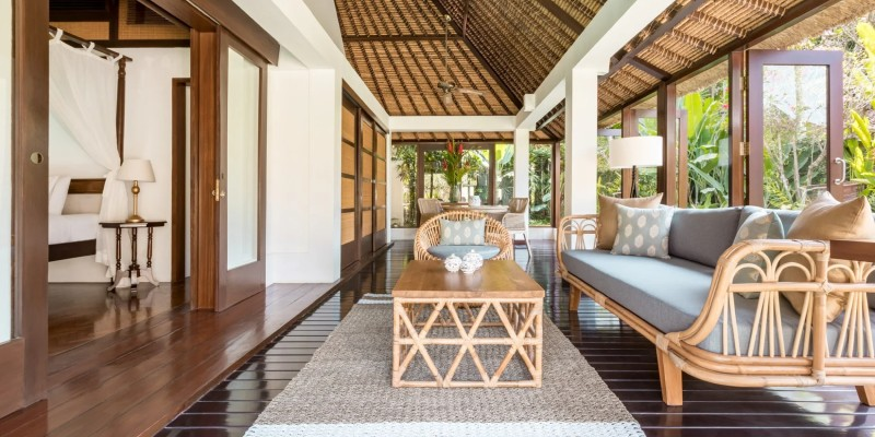 A spacious open-air living area in a One Bedroom Pool Villa at The Pavilions Bali