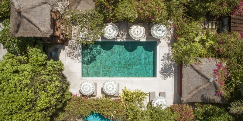 A drone image of the main pool at The Pavilions Bali resort