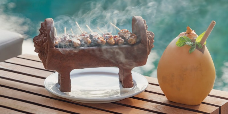 A pool snack sizzles on a decorative skillet