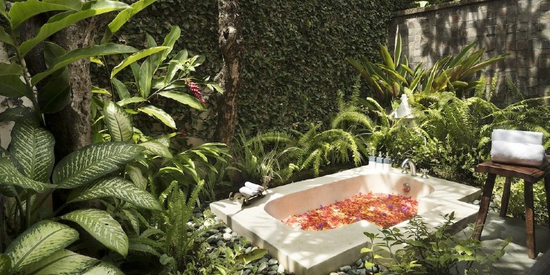 A shot of the outdoor soaking bathtub in a One Bedroom Pool Villa at The Pavilions Bali