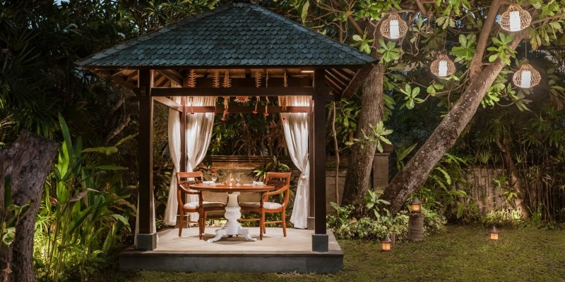 An evening meal set out in a pagoda in the ground of the Pavilions Bali