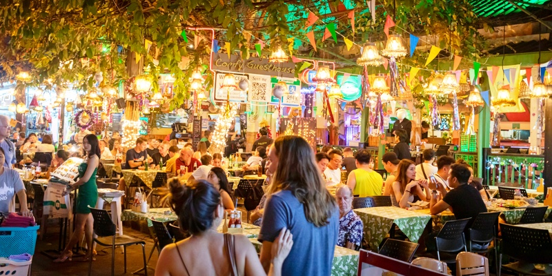 People eating in market area of Bangkok