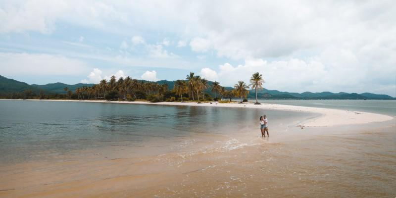 Two people on the beach at Koh Yao Yao island, Thailand