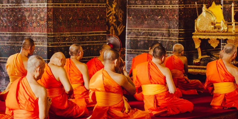 Buddhist monks in prayer in a temple