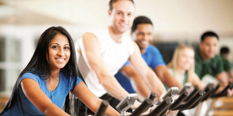 People exercising on bikes in a fitness centre