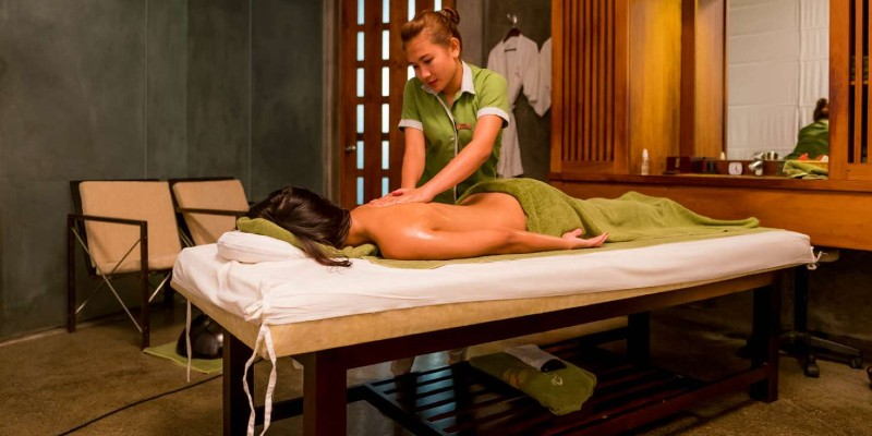 A woman having a massage in a hotel spa