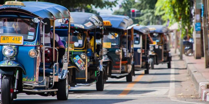 Tuk-tuks line the street in Thailand