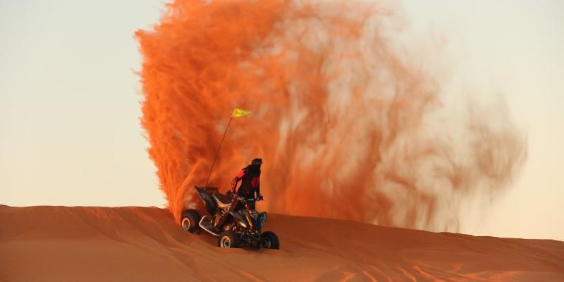 A man on an ATV in the desert