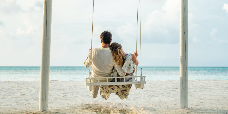 Couple on a swing in the Maldives