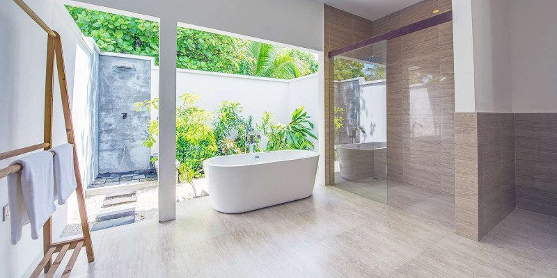 Bathe in the free-standing soaking tub