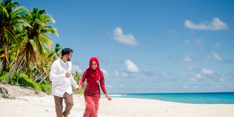 Couple on the beach in the Maldives